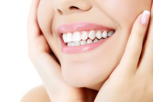 Smiling woman after receiving cosmetic dentistry in Waterdown